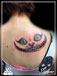 Tatouage - Regard chat Alice omoplate